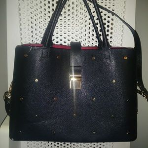 Black leather with gold detail red lining